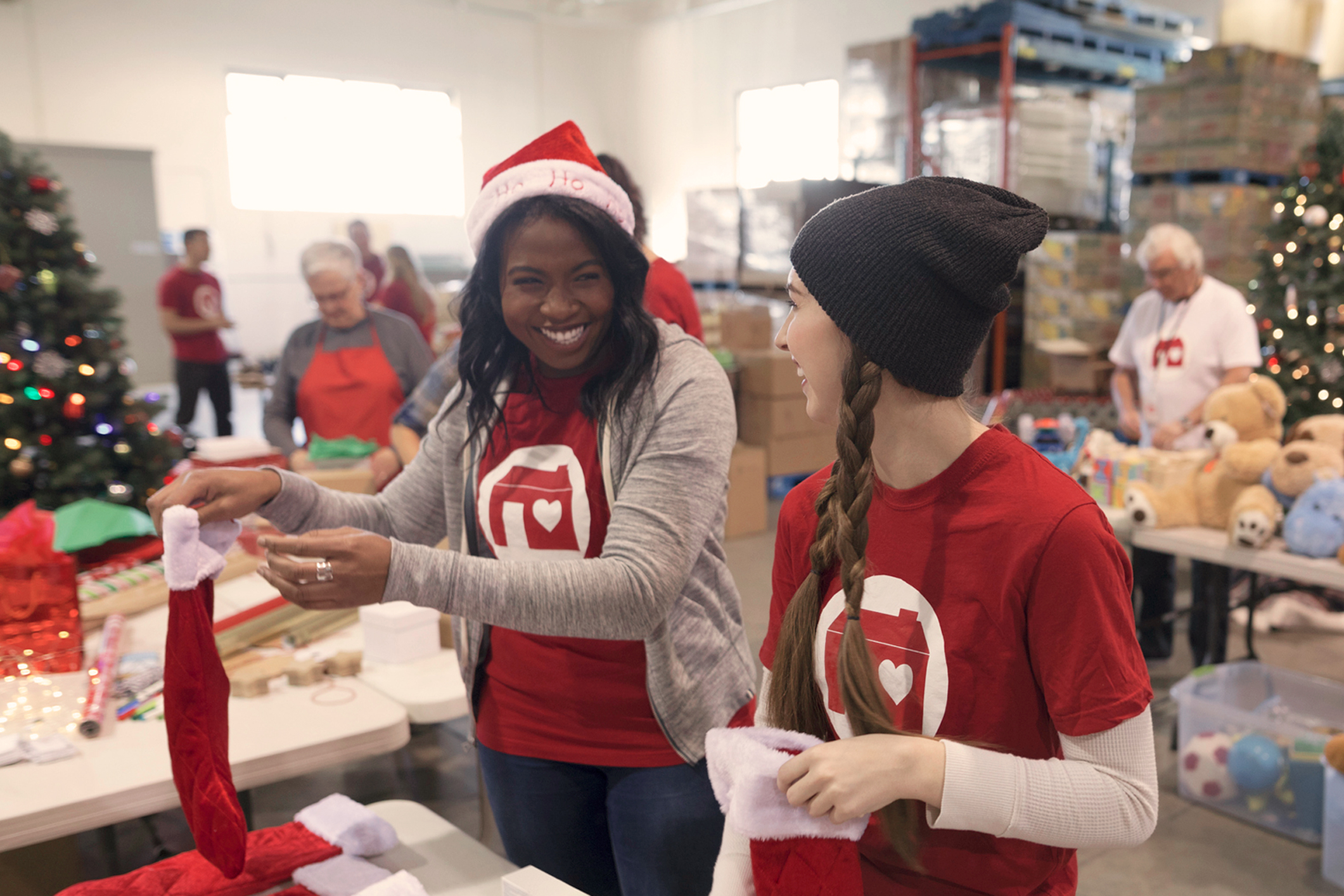 Volunteers Stuffing Holiday Stockings