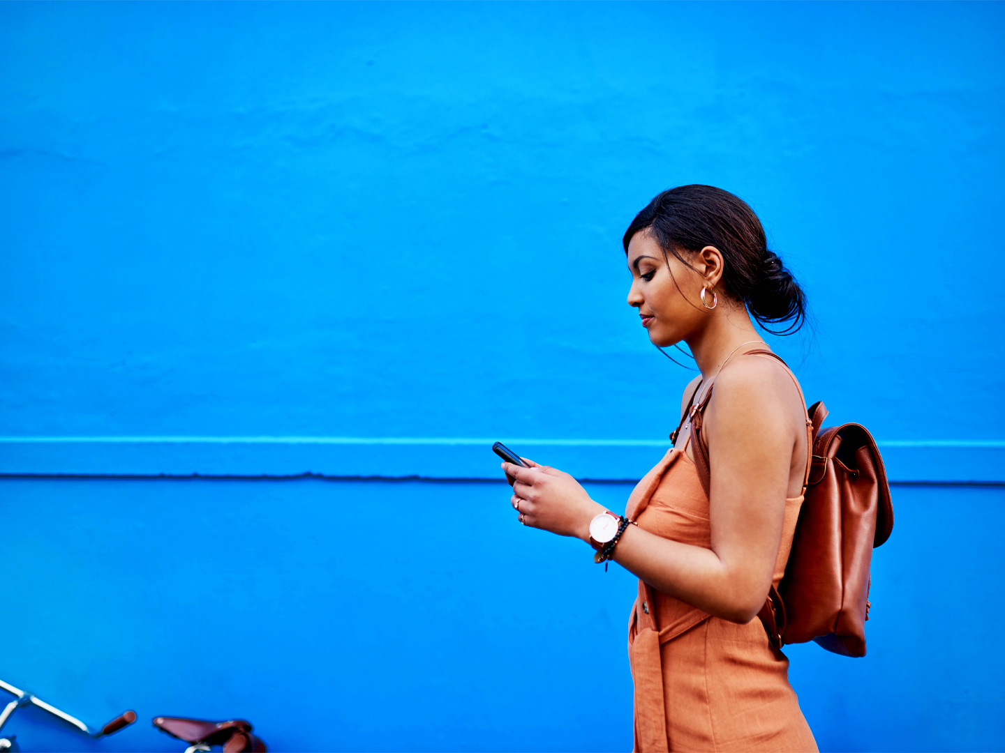 Photo of a woman using a mobile phone