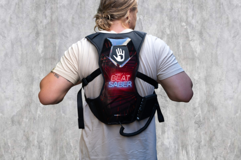 Photo of a man wearing a Beat Saber SUBPAC