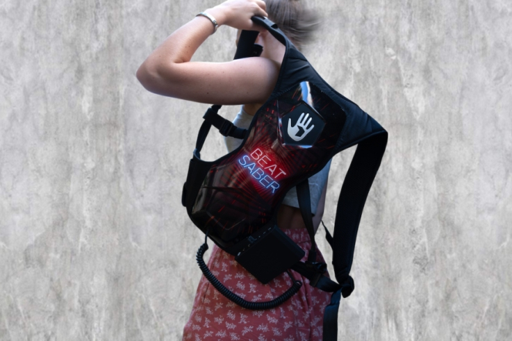 Photo of woman wearing a Beat Saber SUBPAC