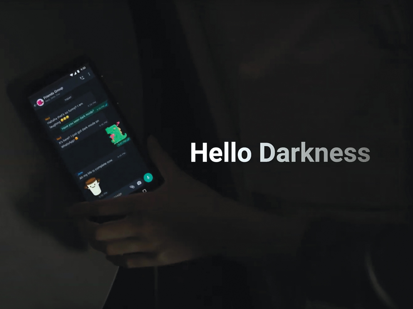 Screenshot of WhatsApp dark mode video (a hand reaching for a phone in a dark room)