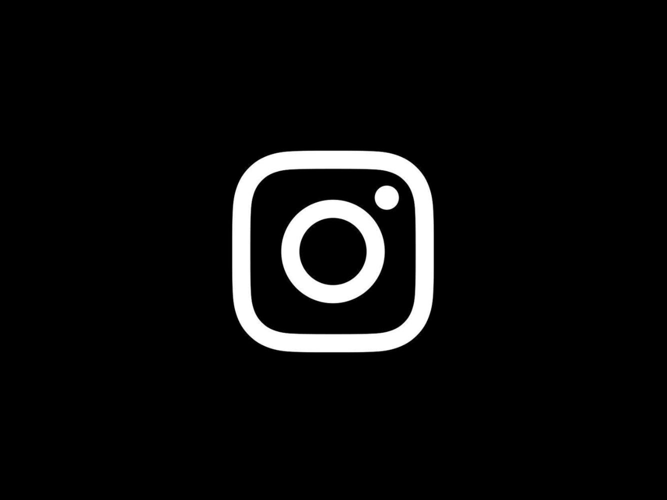 Instagram glyph on black background