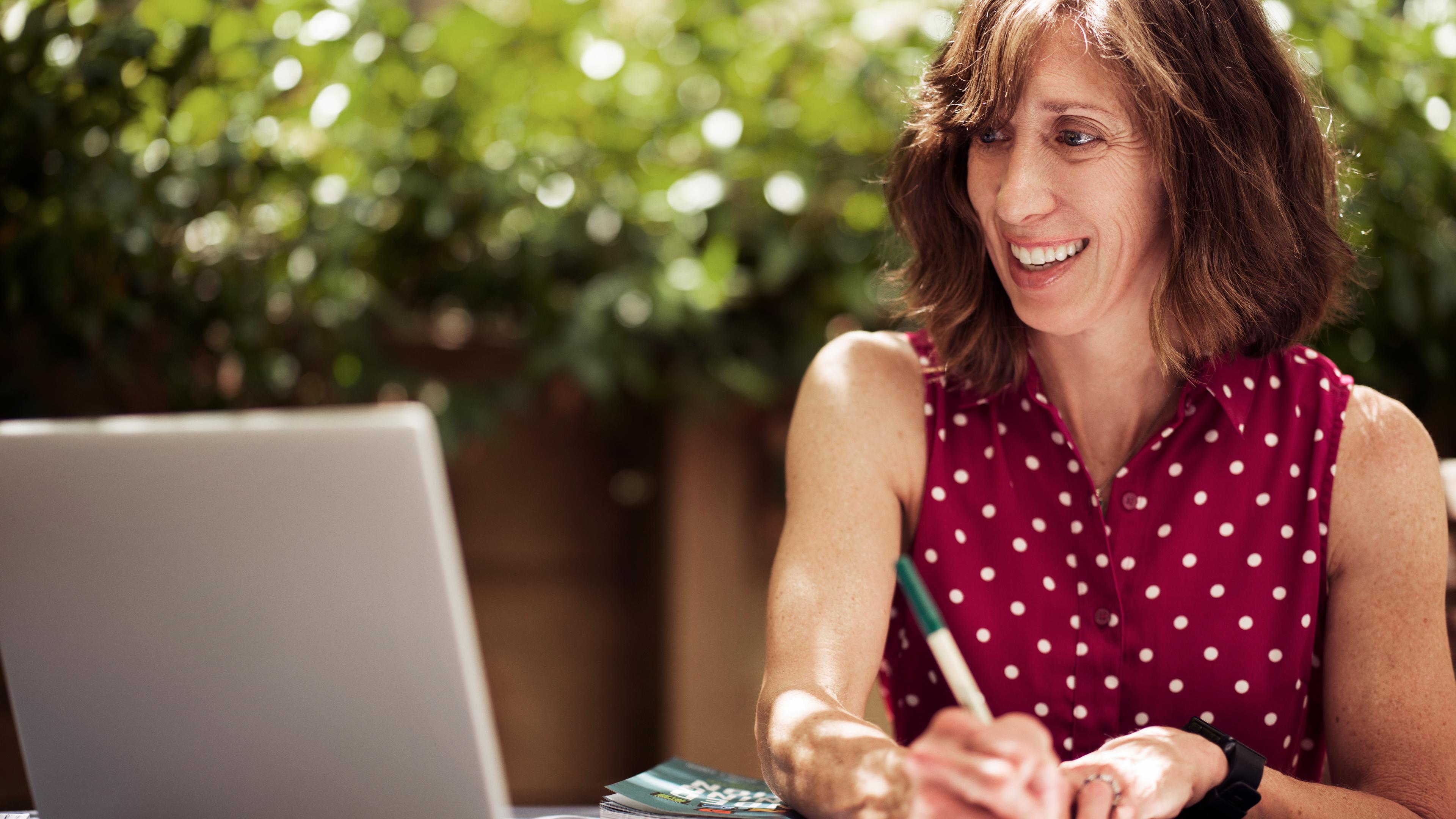 Woman teaching class by computer