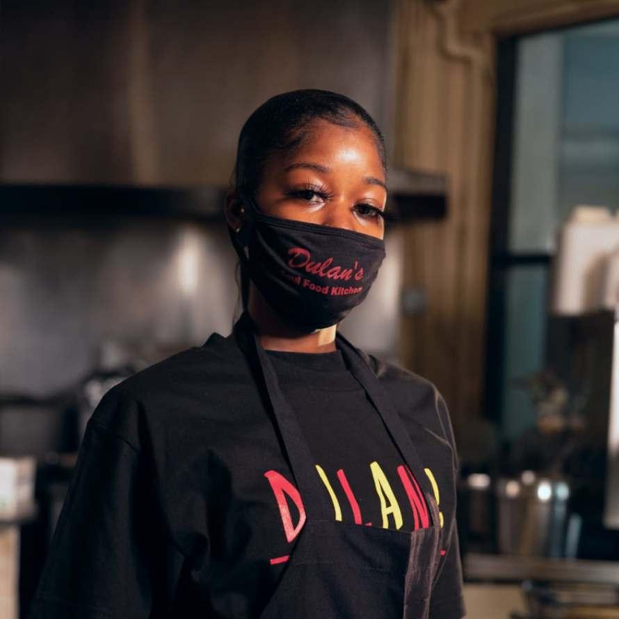Woman wearing mask at Dulan's Soul Food Kitchen, Inglewood, Los Angeles.