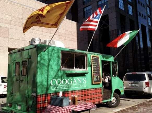 Coogan's community fund food truck parked on street.