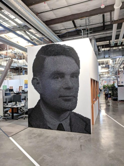 A mural of Alan Turing made out of dominoes at Facebook's headquarters
