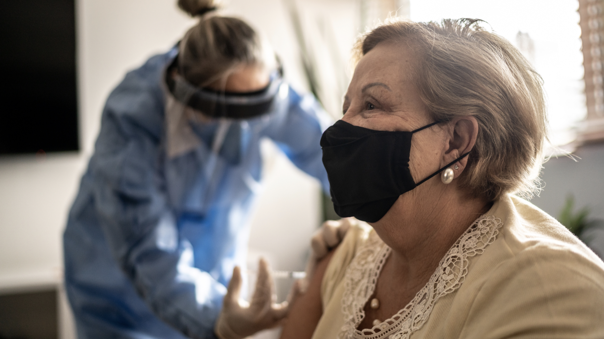 Photo of a woman getting a COVID-19 vaccine